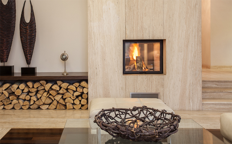 Travertine tile on the floors and fireplace in this brightly lit home